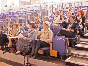 Members vote with raised hands at a CWCA AGM